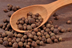 Allspice in a spoon Stock Photo