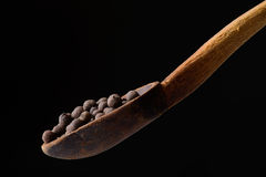 Allspice in a spoon Royalty Free Stock Photo