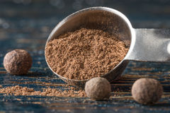 Allspice. Whole allspice and ground allspice spilling from a measuring spoon Stock Photo