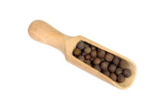 Allspice in a wooden bowl. Black pepper. Spice. isolated on white background Royalty Free Stock Image