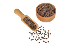 Allspice in a wooden bowl. Black pepper. Spice. isolated on white background Stock Photo