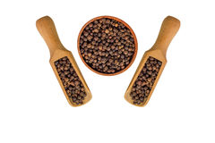 Allspice in a wooden bowl. Black pepper. Spice. isolated on white background Royalty Free Stock Photos
