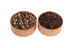 Allspice in a wooden bowl. Black pepper. Spice. isolated on white background Stock Photography