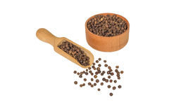 Allspice in a wooden bowl. Black pepper. Spice. isolated on white background Stock Images