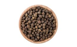 Allspice in wooden bowl isolated on white background. Spices and food ingredients.  stock photos