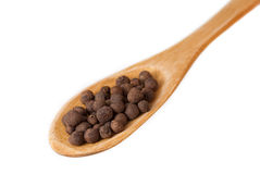 Allspice in wooden spoon isolated on white Stock Photo