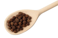 Allspice on wooden spoon Royalty Free Stock Images