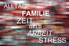 Alltag, Familie, Zeit, Geld, Arbeit, Stress. The german words for & x22;Life, Family, Time, Money, Work, Stress& x22; on a colorful blurred background stock photography
