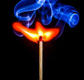 Allumette brûlante Photographie stock