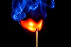 Allumette brûlante Photos stock