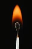 Allumette de cire sur l'incendie Images stock