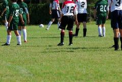 Allumette de football de la fille Photo stock