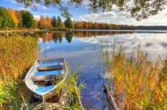 Alluminium boat in Swedish autumn scenery Royalty Free Stock Image