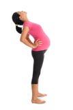 Allungamento asiatico della donna incinta Fotografia Stock
