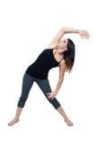 Allungamento atletico della donna (1) Fotografia Stock Libera da Diritti