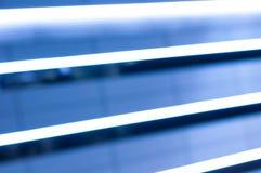 Allungamento blu delle linee del LED Fondo della luce notturna Immagini Stock