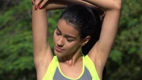 Allungamento del teenager colombiano Immagine Stock