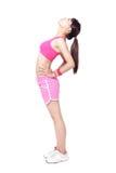 Allungamento dell'atleta che riscalda prima dello sport Fotografia Stock