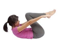 Allungamento dell'istruttore di forma fisica Fotografia Stock Libera da Diritti
