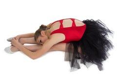 Allungamento della ballerina giovane Fotografia Stock