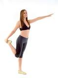 Allungamento della donna di forma fisica Fotografie Stock