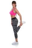 Allungamento della donna di forma fisica di allungamento che sta al trai di allenamento di sport Immagine Stock Libera da Diritti