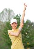 Allungamento della donna di sport Fotografia Stock
