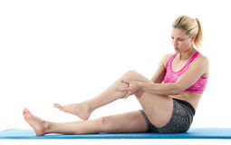 Allungamento della gamba della donna Fotografia Stock