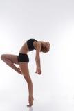 Allungamento della ginnasta della donna Fotografie Stock