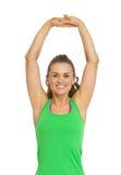 Allungamento della giovane donna di forma fisica Fotografie Stock