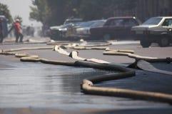 Allungamento delle manichette antincendio Immagini Stock