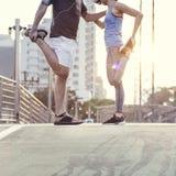 Allungamento dello sport atletico che Worming concetto sano Fotografia Stock Libera da Diritti