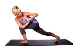 Allungamento di esercizio di yoga Fotografie Stock