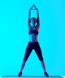 Allungamento di exercices di forma fisica della donna Fotografie Stock