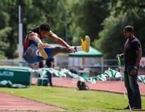 Allungamento di salto in lungo Fotografie Stock