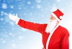 Allungamento di Santa Claus la sua mano Fotografia Stock Libera da Diritti