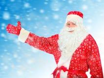 Allungamento di Santa Claus la sua mano Fotografie Stock Libere da Diritti