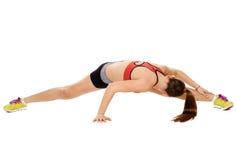 Allungamento di signora di forma fisica Immagine Stock