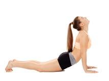 Allungamento di signora di forma fisica Fotografie Stock
