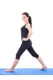Allungamento ed esercizio attraenti della donna isolati su bianco Fotografia Stock Libera da Diritti