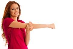 Allungamento - gli allungamenti della donna armano i muscoli dopo l'allenamento i di forma fisica Fotografia Stock Libera da Diritti
