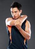 Allungamento maschio di forma fisica Fotografia Stock Libera da Diritti