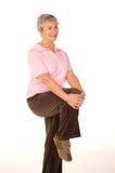 Allungamento maturo della signora più anziana Fotografia Stock