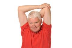 Allungamento pensionato maggiore dell'uomo Immagine Stock Libera da Diritti