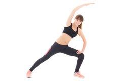Allungamento sportivo della donna isolato su bianco Fotografia Stock