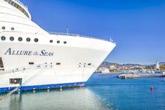 Allure of the Seas in Malaga. Malaga, Spain - April, 29: Allure of the Seas at the malaga harbor as first stop in europe in Malaga, Spain on April 29, 2015. The Royalty Free Stock Photography