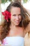 alluring женщина красного цвета цветка Стоковое Изображение RF
