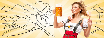 Alluring beer. Young flirting sexy woman wearing red jumper shorts with suspenders in a form of a traditional dirndl, holding a beer mug against sketchy Royalty Free Stock Photos