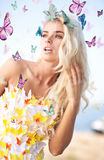 Alluring blonde wearing butterfly dress Stock Photos