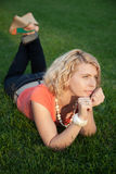 Alluring blonde woman posing in autumn park Royalty Free Stock Photo